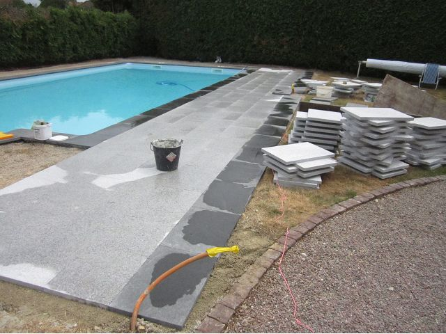 Jet black and grey granite pool deck